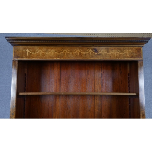 18 - A 19th century style burr elm floor standing open bookcase with satinwood swag inlaid frieze on plin...