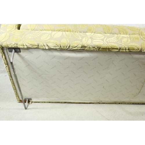 110 - A contemporary Designers Guild chaise in cut floral upholstery on chrome supports. H.65 W.175 D.85cm