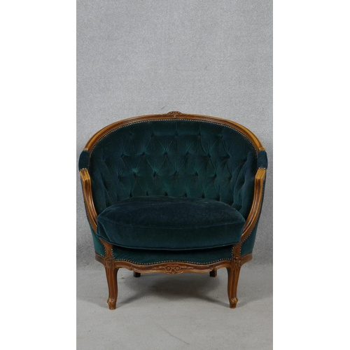 156 - A pair of French style carved beech framed tub armchairs in deep buttoned velour upholstery on cabri...
