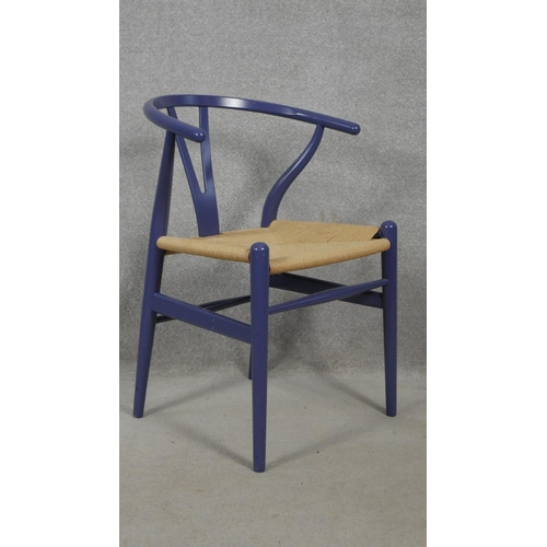 163 - A pair of Carl Hansen and Sons wishbone chairs by Hans J Wegner with label to underside. H.76cm