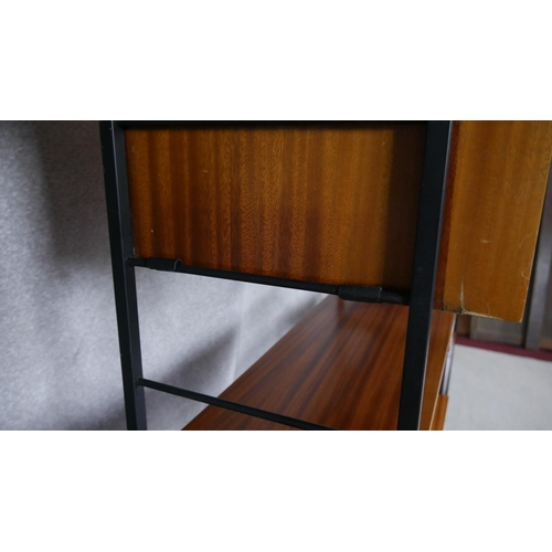 188 - A large mid century teak Ladderax bookcase and shelving system. H.199 W.330cm.