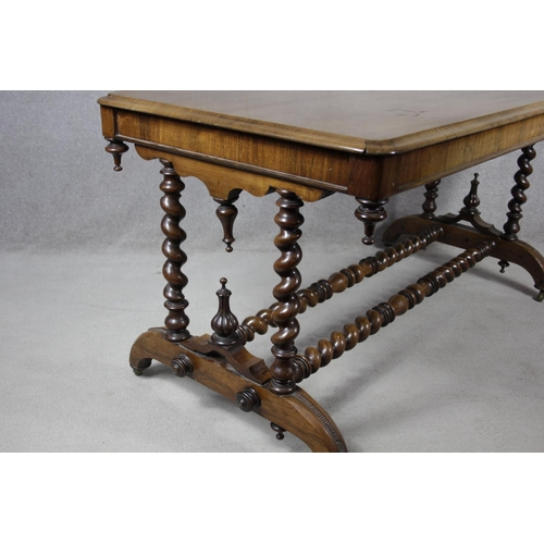 226 - A mid 19th century rosewood library table with turned finials on barleytwist stretchered supports. H...
