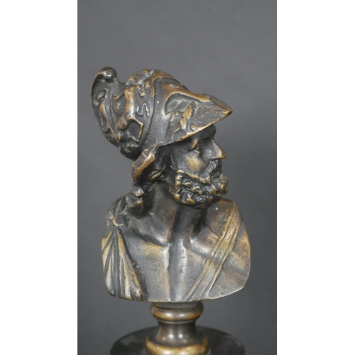 331 - A pair of bronze columns each with a bust of king Menelaus raised on square stepped plinth bases. H....
