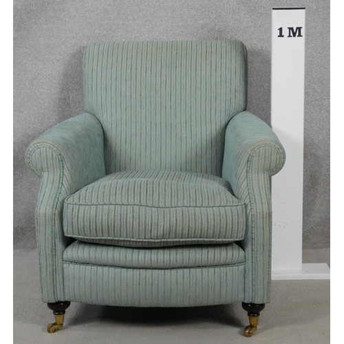 11 - A contemporary 19th century style upholstered armchair on turned mahogany bun supports terminating i...