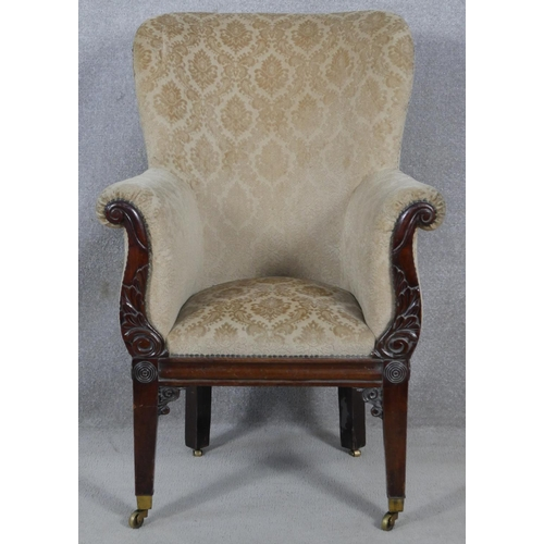12 - A Regency carved mahogany framed tub armchair in cut floral upholstery raised on square tapering sup...