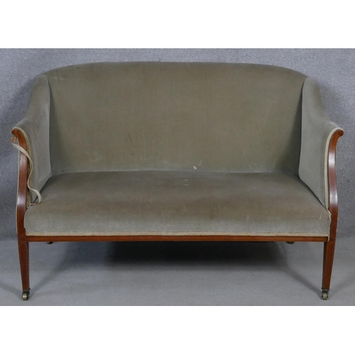 13 - An Edwardian mahogany and satinwood strung upholstered two seater tub shaped canape. H.85 W.130 D.64...