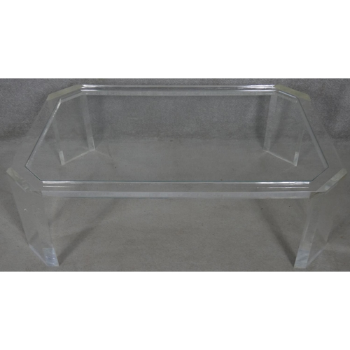 28 - A late 20th century designer clear lucite coffee table. H.38.5 L.120 W.79cm
