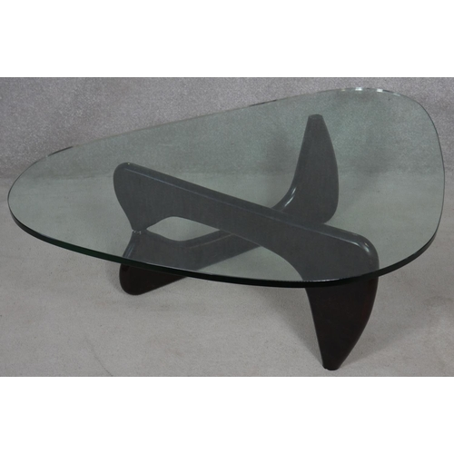 7 - A Noguchi style coffee table with plate glass top on lacquered swivel base. H.40 L.130 W.91.5cm