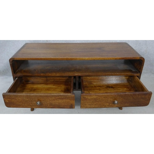 66 - A mid century vintage teak low table fitted with base drawers on dansette supports. H.46.5 L.89.5 W....
