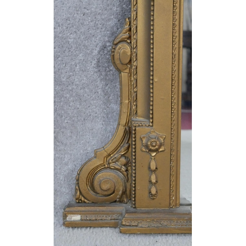 67 - A late 19th century gilt overmantel mirror with Classical style Jasperware intaglio to the cresting ...