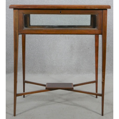 5 - An Edwardian mahogany, satinwood crossbanded and ebony strung vitrine on square tapering supports un...