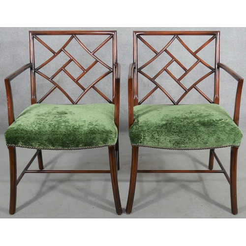 107 - A pair of mahogany Chinese faux bamboo style open armchairs. H.88cm