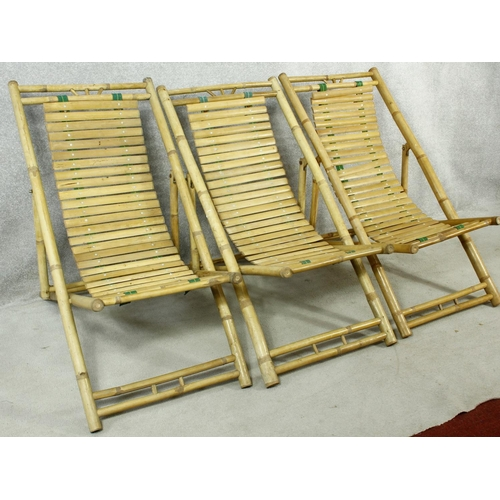 159 - Three bamboo and slatted deck chairs. H.96cm (one in need of repair as photographed).