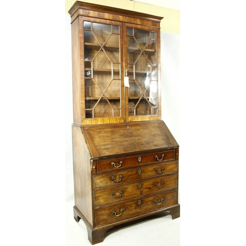 160 - A Georgian mahogany two section bureau bookcase with upper astragal glazed top above fall front encl...