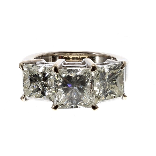 Fine and impressive 18ct white gold princes-cut three stone diamond ring, 2.94ct , 3.24ct, 2.93ct approx, clarity VS1-1, colour I/L, band width 10mm, 11.3gm, ring size N (estimated 9.11ct in total) (219)