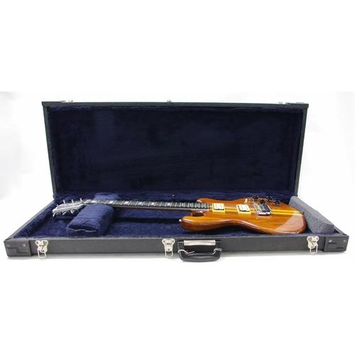 56 - Late 1970s Kramer DMZ 2000 electric guitar, made in USA, ser. no. 0xxx0; Finish: walnut, various din...