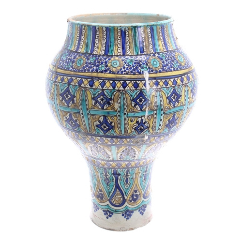 """Large Eastern Iznik turquoise and blue glaze pottery vase, of inverted baluster form, decorated overall with stylised flowers and geometric borders, 17"""" high (at fault with a crack to rim spreading down towards the body)"""