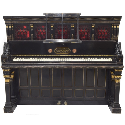 """William James Audsley (1833-1907) and George Ashdown Audsley (1838-1945) for W.M.H and G.H Dreaper - a rare Victorian Egyptian revival ebonised upright piano, circa 1880, the parcel gilt and scratch carved case with a folding music stand and fabric backed fretwork panels with Greek key borders, the keyboard flanked by a pair of sphinxes over square columns with foliate carved cappings and a panelled footboard, the frame stamped 'Dreapers Patent L'Pool 4017/2642', the interior fall board with brass inlay inscribed 'WM.H. & G.H. Dreaper, 96 Bond Street Liverpool, inlaid medallions for the 1878 Paris Exhibition, 61"""" wide, 49"""" high. depth 25.5"""""""