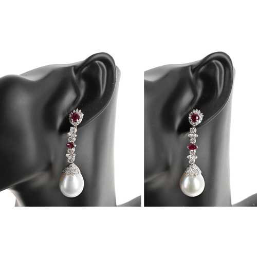 Very attractive and fine pair of 18ct white gold ruby, diamond and pearl drop earrings, with mixed-cut stones over single pearls of good lustre and large size each measuring 16.5mm, 25.3gm, diamonds 2.80ct approx in total, clarity VS-SI, colour G/H, length 57mm, boxed (no butterfly backs)