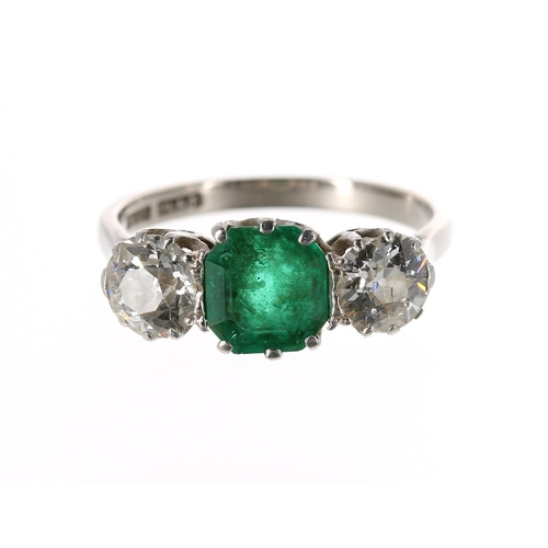 Impressive 18ct and platinum emerald and diamond three stone ring, the radiant-cut emerald 1.15ct approx, with round old-cut diamonds to either side, each 0.65ct approx, clarity SI, colour I/J, 4gm, width 8mm, ring size P