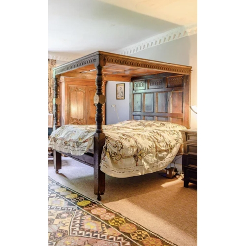 """Antique oak carved panelled tester bed, with carved arcaded decoration and cup and cover supports, 56"""" wide"""