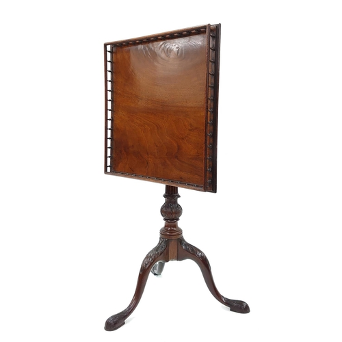 """Fine 18th century English mahogany birdcage tripod table in the manner of Thomas Chippendale, the square galleried top over the birdcage mechanism supported upon a turned fluted and acanthus carved column with triple curving acanthus carved legs, the table top 22"""" square, height folded down 31.25"""", height with top raised 42"""""""