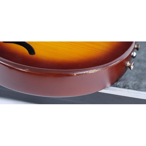 53 - Gordon Smith Gypsy semi-hollow body electric guitar, made in England; Finish: amber burst, heavy scr...
