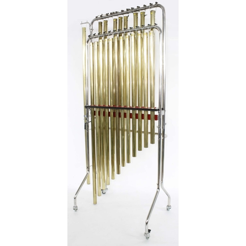 Paul Chalklin - set of twenty chromatic brass tubular bells, C to G upon a bespoke chromed stand, 13 bells E flat - G former property of Tommy and Jimmy Blades; together with three low brass bells in A, B flat and B natural made by Ken Webb; a short brass bell approximately C sharp for use as a bell effect; two Olympic stands adapted for tubular bells with hooks and spacer rail; also an extendable tubular bell frame for five bells of assorted lengths