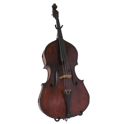 """Very interesting 18th century Italian or English double bass, unlabelled, the two piece back of faint medium curl with similar wood to the sides, the later head of plainish wood, the table of a medium width grain and the varnish of a reddish-brown colour on a golden ground, length of back 42 1/2"""", stop length 22.75"""" and vibrating string length 40"""" *This instrument is sold with a valuation and appraisal from A. Pryce (Stringed Instruments of Wadhurst), East Sussex) dated 10th October 1989. The double bass was valued by this dealer at £6000 and described as Milanese dating from 1750"""