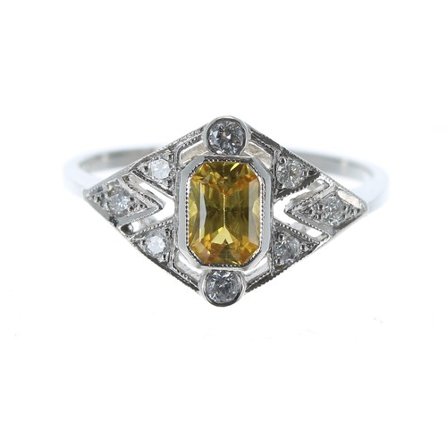 Fancy Art Deco style platinum yellow sapphire and diamond dress ring, the sapphire 0.75ct approx, width 11.5mm, 3.5gm, ring size O