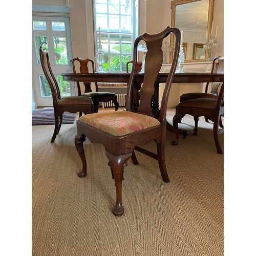 Fine set of six George I walnut dining chairs, with paper scroll top rails over vase shaped splats, drop-in seats and cabriole legs with pad feet (6)