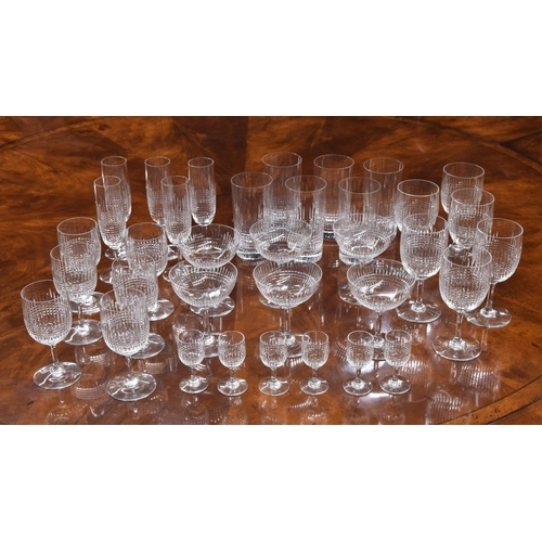 1025 - Baccarat 'Nancy' pattern drinking glasses comprising, six champagne coups, five flutes, six small an...