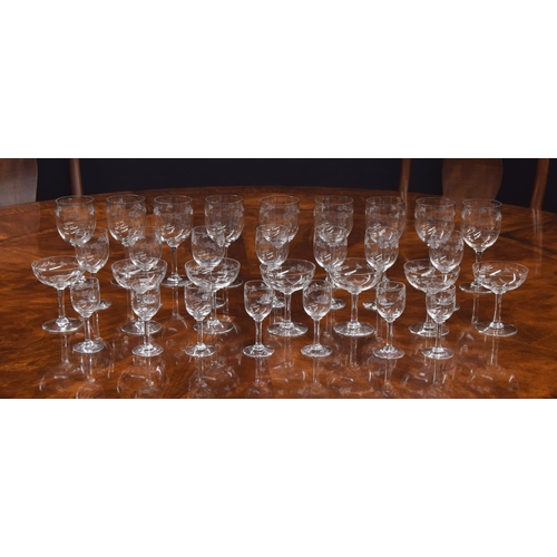 1015 - Suite of drinking glasses with engraved floral decoration, possibly Baccarat, comprising seven champ...