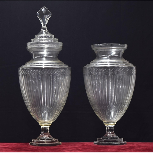 1036 - Tall pair of ovoid glass pedestal vases, with fluted decoration upon stepped hexagonal bases, 21