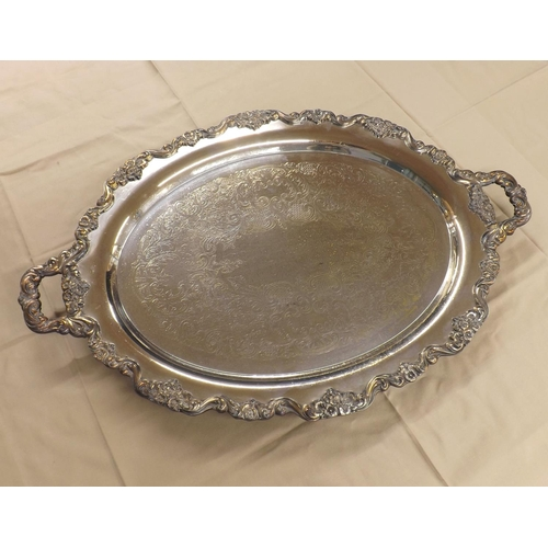 1046 - Good large silver plated engraved twin-handled serving tray, with a cast foliate shaped border upon ...