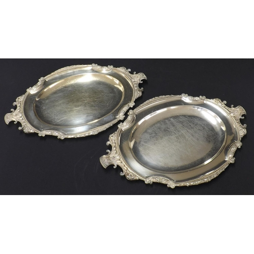 1048 - Pair of Elkington silver plated oval meat serving plates, with cast foliate and sheep head mounts wi...