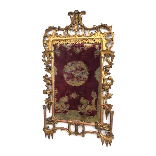 """George III style carved and gilded wall mirror, with rococo scroll and rocaille work and trailing flowers, 47.25"""" high, ? wide"""