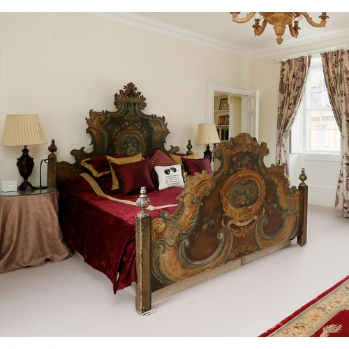 """Fine and decorative Italian painted bed, with shaped head and footboards applied with turned finials, painted with flowers and foliage with scrolls, the headboard inscribed 'BUONA SALUTE', 72.5"""" high, 84.25"""" long, 71.5"""" wide"""