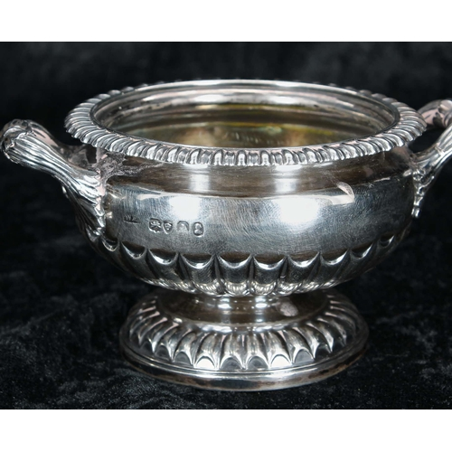 508 - Amendment Pair of George IV silver salts,of squat campagna form with twin-handles and half reeded b...
