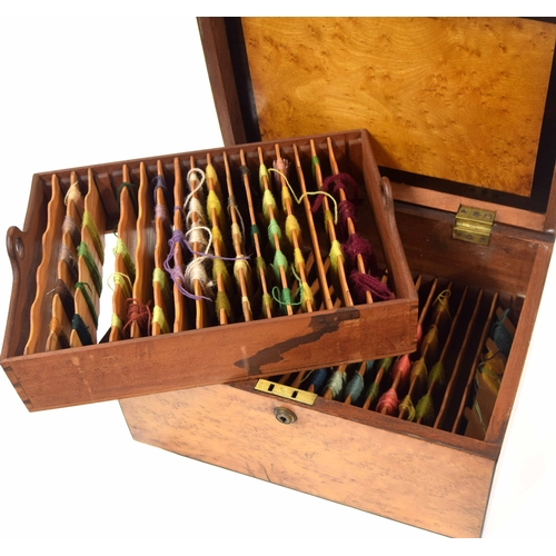 568 - 19th century 'birds eye' maple crossbanded thread box, the hinged cover enclosing double tier remova...