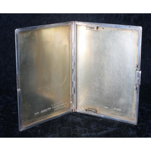 523 - Silver cigarette case, with engine turned decoration and gilt interior, named inscription to the int...