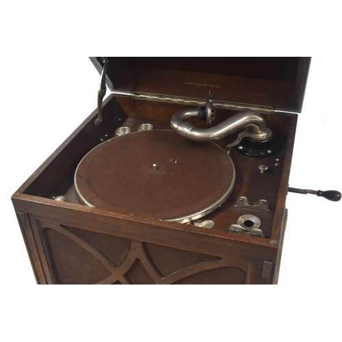 572 - His Masters Voice (HMV) wind-up table top gramophone, within oak case with fretwork grille below, mo...