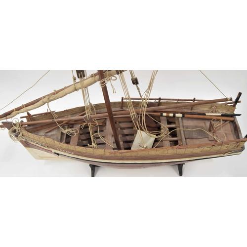 573 - Hand built scale model Kenyan/Lamu island sailingboat, upon stand engravedLamu 1974, 30