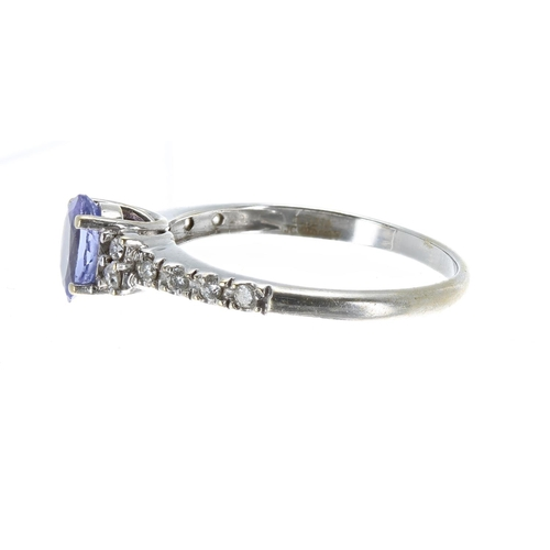 41 - 18ct white gold tanzanite and diamond dress ring, the oval tanzanite 0.60ct approx, set with round b...