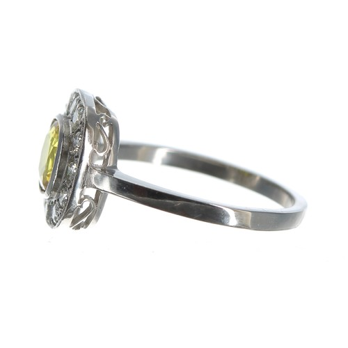 40 - Art Deco style platinum yellow sapphire and diamond cluster ring, the sapphire 1.00ct approx, with r...