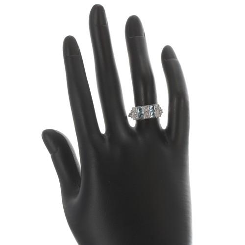 50 - Platinum Art Deco style aquamarine and diamond ring, with four princess-cut aquamarines estimated 0....