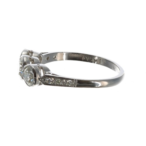 55 - Good platinum three stone diamond ring with set shoulders, rub-over set round brilliant-cuts, 1.20ct...