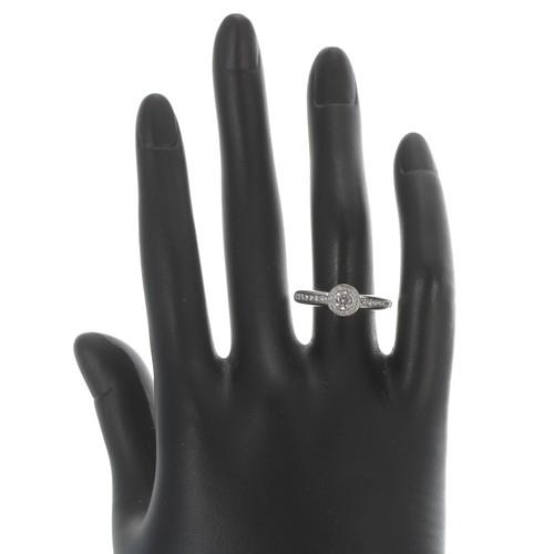 49 - 18ct white gold diamond cluster ring, the centre diamond 0.25ct, clarity SI, colour H/I, 0.47ct appr...