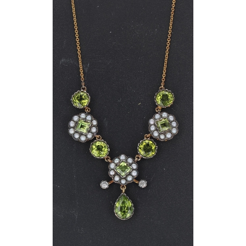 27 - Ornate necklace set with round and square peridot, seed pearls and diamonds with a suspended pear sh...