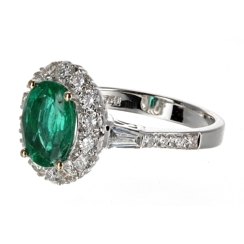 37 - Fine 18ct white gold quality oval emerald and diamond cluster ring with diamond shoulders, the emera...